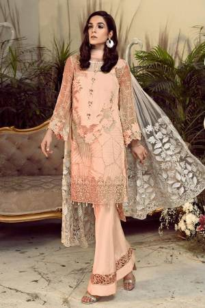 Grab This Pretty Heavy Embroidered Pakistani Designer Suit In Peach Color. Its Embroidered Top Is Georgette Based Paired With Santoon Bottom and Net Fabricated Embroidered Dupatta.