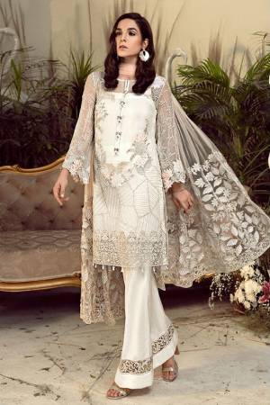 Grab This Pretty Heavy Embroidered Pakistani Designer Suit In White Color. Its Embroidered Top Is Georgette Based Paired With Santoon Bottom and Net Fabricated Embroidered Dupatta.