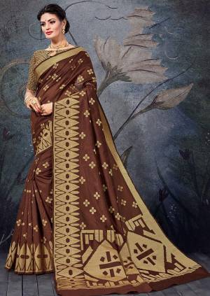 Here Is A Pretty Rich Designer Weaved Saree In Brown Color. This Saree And Blouse Are Fabricated On Handloom Cotton Which Is Durable And Easy To Care For.