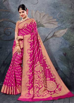 Here Is A Pretty Rich Designer Weaved Saree In Rani Pink Color. This Saree And Blouse Are Fabricated On Handloom Cotton Which Is Durable And Easy To Care For.