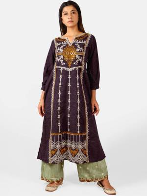 You Will Definitely Earn Lots Of Compliments Wearing This Designer Readymade Pair Of Kurti And Plazzo In Wine And Pastel Green Color. This Readymade Pair Is Fabricated On Khadi Beautified With Thread Work. Buy This Readymade Pair Now.