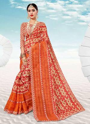 Pretty Simple Saree For Your Casual Or Semi-Casual Wear Is Here In Red And Cream Color. This Saree And Blouse Are Fabricated On Kota Silk Beautified With Prints All Over.