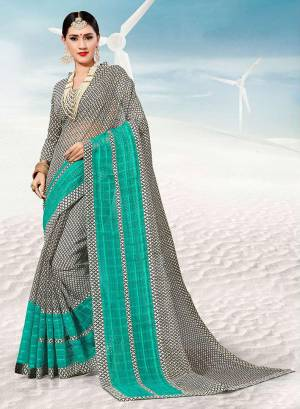 Pretty Simple Saree For Your Casual Or Semi-Casual Wear Is Here In Black and White Color. This Saree And Blouse Are Fabricated On Kota Silk Beautified With Prints All Over.
