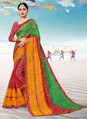 Pretty Simple Saree For Your Casual Or Semi-Casual Wear Is Here In Red And Green Color. This Saree And Blouse Are Fabricated On Kota Silk Beautified With Prints All Over.