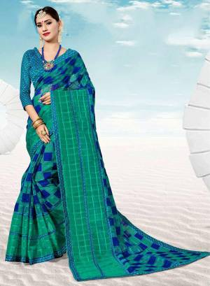 Pretty Simple Saree For Your Casual Or Semi-Casual Wear Is Here In Sea Green And Royal Blue Color. This Saree And Blouse Are Fabricated On Kota Silk Beautified With Prints All Over.
