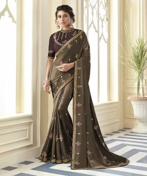 Flaunt Your Rich And Elegant Taste Wearing This Designer Saree In Light Brown Color Paired With Dark Brown Colored Blouse. This Saree Is Fabricated On Satin Silk Paired With Art Silk Fabricated Blouse.