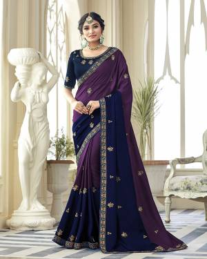 You Will Definitely Earn Lots Of Compliments Wearing This Designer Saree In Purple And Navy Blue Color Paired With Contrasting Navy Blue Colored Blouse. This Embroidered Saree Is Satin Silk Based Paired With Art Silk Fabricated Blouse. Buy Now.