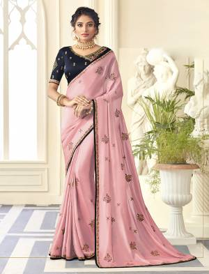 Flaunt Your Rich And Elegant Taste Wearing This Designer Saree In Pink Color Paired With Navy Blue Colored Blouse. This Saree Is Fabricated On Satin Silk Paired With Art Silk Fabricated Blouse.
