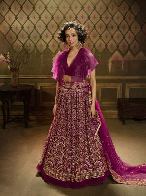 Get Ready For This Wedding Season Wearing This Heavy Designer Lehenga Choli In Rani Pink Color. This Beautiful Heavy Embroidered Lehenga Choli Is Fabricated On Net Beautified With Jari Embroidery And Sequence Work.