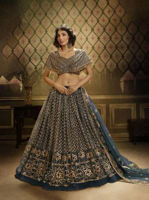Here Is Lovely Heavy Trendy Designer Lehenga Choli In Teal Blue Color. This Pretty Lehenga, Choli And Dupatta Are Fabricated On Net Beautified With Jari Embroidery And Sequence Work. Buy Now.