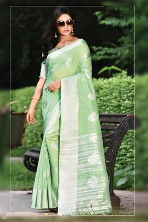 For Your Semi-Casual Or Festive Wear, Grab This Pretty Designer Saree In Light Green Color. This Saree And Blouse Are Fabricated On Linen Cotton Beautified With Weave. Buy This Elegant Looking Saree Now.