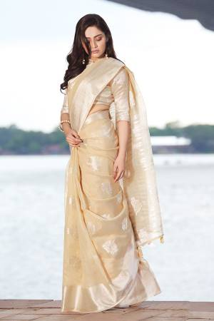 Simple And Elegant Looking Saree Is Here In Cream Color. This Saree and Blouse Are Fabricated On Linen Cotton Beautified With Weave. It Is Light In Weight and Easy To Carry All Day Long.