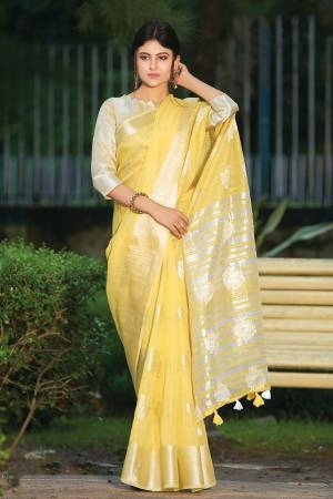 For Your Semi-Casual Or Festive Wear, Grab This Pretty Designer Saree In Yellow Color. This Saree And Blouse Are Fabricated On Linen Cotton Beautified With Weave. Buy This Elegant Looking Saree Now.