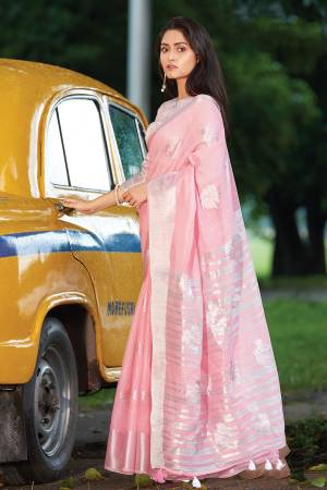 Simple And Elegant Looking Saree Is Here In Baby Pink Color. This Saree and Blouse Are Fabricated On Linen Cotton Beautified With Weave. It Is Light In Weight and Easy To Carry All Day Long.