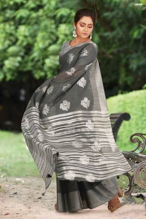 For Your Semi-Casual Or Festive Wear, Grab This Pretty Designer Saree In Grey Color. This Saree And Blouse Are Fabricated On Linen Cotton Beautified With Weave. Buy This Elegant Looking Saree Now.