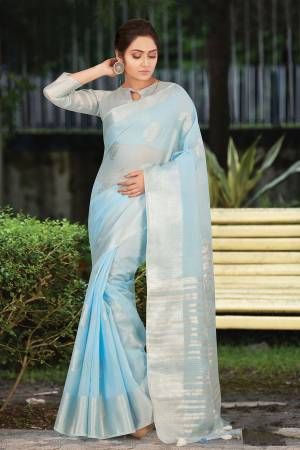 Simple And Elegant Looking Saree Is Here In Baby Blue Color. This Saree and Blouse Are Fabricated On Linen Cotton Beautified With Weave. It Is Light In Weight and Easy To Carry All Day Long.