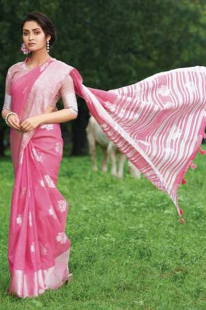 For Your Semi-Casual Or Festive Wear, Grab This Pretty Designer Saree In Pink Color. This Saree And Blouse Are Fabricated On Linen Cotton Beautified With Weave. Buy This Elegant Looking Saree Now.