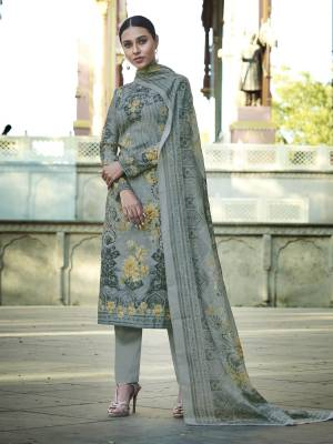 Add This Beautiful Digital Printed Designer Straight Suit In Grey Color To Your Wardrobe. This Pretty Suit Is cotton Based Beautified With Digital Print And Thread Work. Buy Now.