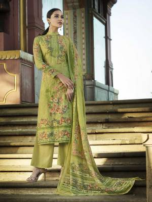 Add This Beautiful Digital Printed Designer Straight Suit In Green Color To Your Wardrobe. This Pretty Suit Is cotton Based Beautified With Digital Print And Thread Work. Buy Now.