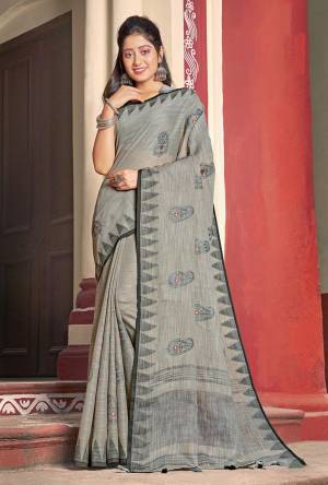 Flaunt Your Rich and Elegant Taste Wearing This Designer Saree In Grey Color Paired With Grey Colored Blouse. This Saree And Blouse Are Fabricated On Linen Cotton Beautified With Thread Work. Its Rich And Fabric Will Earn You Lots Of Compliments From Onlookers.