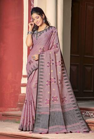 Simple And Elegant Looking Linen Based Designer Saree Is Here In Pink Color Paired With Grey Colored Blouse. This Saree And Blouse Are Fabricated On Linen Cotton Beautified With Thread Work.