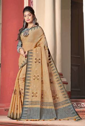 Flaunt Your Rich and Elegant Taste Wearing This Designer Saree In Occur Yellow Color Paired With Grey Colored Blouse. This Saree And Blouse Are Fabricated On Linen Cotton Beautified With Thread Work. Its Rich And Fabric Will Earn You Lots Of Compliments From Onlookers.