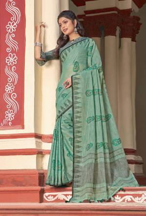 Simple And Elegant Looking Linen Based Designer Saree Is Here In Sea Green Color Paired With Grey Colored Blouse. This Saree And Blouse Are Fabricated On Linen Cotton Beautified With Thread Work.