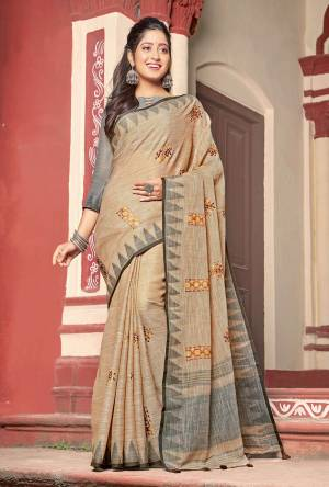 Flaunt Your Rich and Elegant Taste Wearing This Designer Saree In Beige Color Paired With Grey Colored Blouse. This Saree And Blouse Are Fabricated On Linen Cotton Beautified With Thread Work. Its Rich And Fabric Will Earn You Lots Of Compliments From Onlookers.