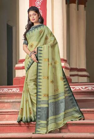 Simple And Elegant Looking Linen Based Designer Saree Is Here In Light Green Color Paired With Grey Colored Blouse. This Saree And Blouse Are Fabricated On Linen Cotton Beautified With Thread Work.