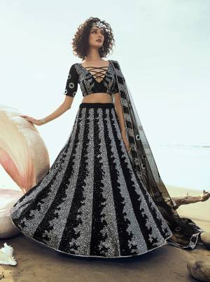 For A Bold And Beautiful Look, Grab This Attractive Looking Heavy Designer Lehenga Choli In Black Color. This Lehenga Choli And Dupatta Are Fabricated On Net With Attractive Sequence Work.