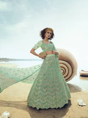Look Pretty Wearing This Heavy Embroidered Lehenga Choli In Pastel Green Color. This Pretty Lehenga, Choli And Dupatta Are Fabricated On Net Beautified With Heavy Sequence Work. Its Pretty Color And Embroidery Will Earn You Lots Of Compliments From Onlookers.