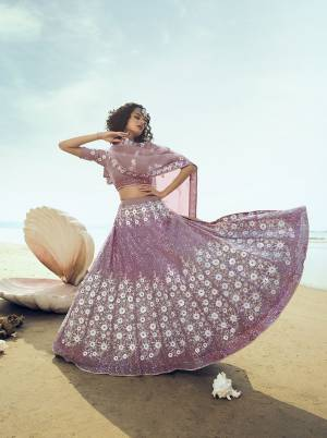 Catch All Limelight Wearing This Heavy Designer Lehenga Choli In Lilac Color. Its Blouse, Lehenga And Dupatta Are Fabricated On Net Beautified With Heavy Attractive Sequence Work. Buy This Pretty Lehenga Now.