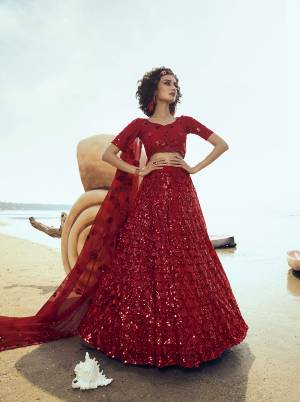 Flaunt Your Rich And Elegant Taste Wearing This Heavy Designer Lehenga Choli In Red Color. Its Heavy Embroidered Lehenga, Choli and Dupatta Are Fabricated On Net. Buy This Pretty Piece Now.