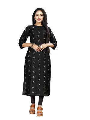 Here Is Simple And Elegant Looking Readymade Straight Kurti In Black Color. This Kurti Is Fabricated On Muslin Beautified With Foil Prints And Available In All Regular Sizes.