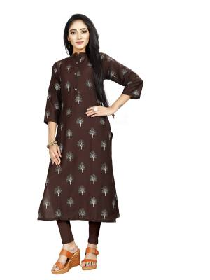 Here Is Simple And Elegant Looking Readymade Straight Kurti In Brown Color. This Kurti Is Fabricated On Muslin Beautified With Foil Prints And Available In All Regular Sizes.