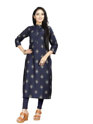 Here Is Simple And Elegant Looking Readymade Straight Kurti In Navy Blue Color. This Kurti Is Fabricated On Muslin Beautified With Foil Prints And Available In All Regular Sizes.