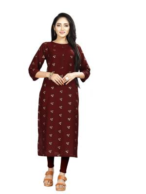 Here Is Simple And Elegant Looking Readymade Straight Kurti In Maroon Color. This Kurti Is Fabricated On Muslin Beautified With Foil Prints And Available In All Regular Sizes.
