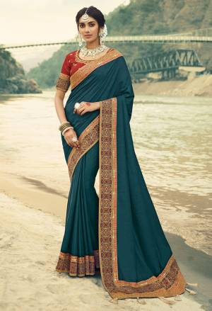 Here Is A Beautiful Designer Saree In Blue Color Paired With Contrasting Red Colored Blouse. This Saree Is Fabricated On Vichitra Silk With Jacquard Silk Border Paired With Art Silk Fabricated Blouse. This Pretty Saree Is Easy To Drape And Carry All Day Long. Buy Now.