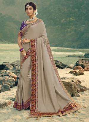 Flaunt Your Rich and Elegant Taste Wearing This Designer Saree In Grey Color Paired With Purple Colored Blouse. This Saree Is Fabricated On Vichitra Silk Paired With Art Silk Fabricated Blouse. Its Rich Fabric And Color Will Earn You Lots Of Compliments From Onlookers.