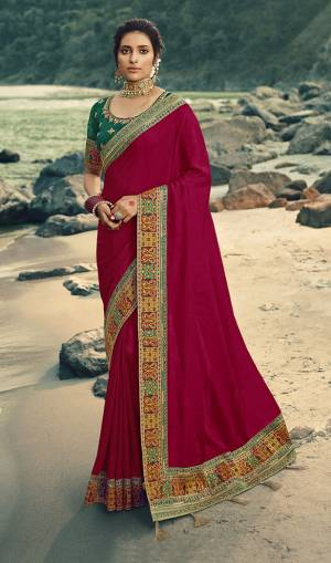 Flaunt Your Rich and Elegant Taste Wearing This Designer Saree In Magenta Pink Color Paired With Dark Green Colored Blouse. This Saree Is Fabricated On Vichitra Silk Paired With Art Silk Fabricated Blouse. Its Rich Fabric And Color Will Earn You Lots Of Compliments From Onlookers.