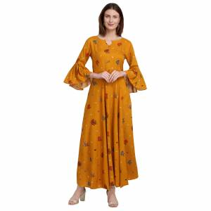 For Your Semi-Casuals, Grab This Designer Readymade Long Kurti In Musturd Yellow Color Fabricated On Rayon. It Is Beautified With Foil Prints And You Can Pair This Up With Some Accessories For A Festive Look. Buy Now.