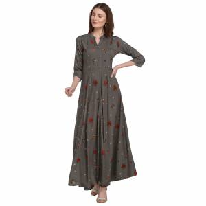 For Your Semi-Casuals, Grab This Designer Readymade Long Kurti In Grey Color Fabricated On Rayon. It Is Beautified With Foil Prints And You Can Pair This Up With Some Accessories For A Festive Look. Buy Now.