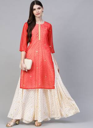 Grab This Readymade Long Kurti In Cream And Red Color Fabricated On Crepe Beautified With Foil Prints. It Is Light In Weight And Easy To Carry All Day Long.