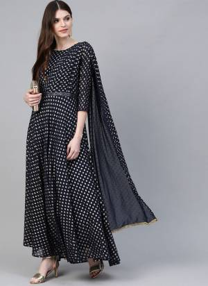 Add This Beautiful Readymade Kurti In Navy Blue Color Fabricated On Georgette Beautified With Prints. It Is Light Weight and Available In All Regular Sizes.