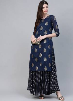 Add This Beautiful Readymade Kurti In Navy Blue Color Fabricated On Chanderi Beautified With Prints. It Is Light Weight and Available In All Regular Sizes.