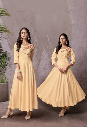 Celebrate This Festive Season With Beauty And Comfort Wearing This Readymade Long Kurti In Cream Color Fabricated Rayon. This Pretty Kurti Is Beautified With Multi Colored Thread Work Giving An Attractive Look. Also It Is Available In All Regular Sizes.