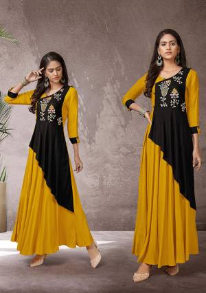 Celebrate This Festive Season With Beauty And Comfort Wearing This Readymade Long Kurti In Musturd Yellow And Black Color Fabricated Rayon. This Pretty Kurti Is Beautified With Multi Colored Thread Work Giving An Attractive Look. Also It Is Available In All Regular Sizes.