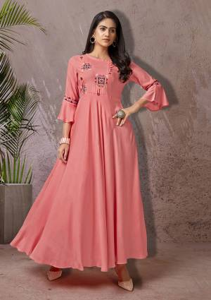 Celebrate This Festive Season With Beauty And Comfort Wearing This Readymade Long Kurti In Pink Color Fabricated Rayon. This Pretty Kurti Is Beautified With Multi Colored Thread Work Giving An Attractive Look. Also It Is Available In All Regular Sizes.