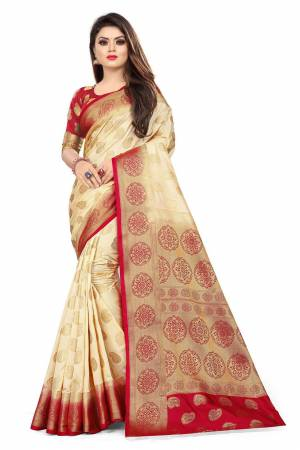 For A Proper Traditional Look, Grab This Heavy Weaved Silk Based Designer Saree In Cream Color Paired with Red Colored blouse. This Saree and Blouse Are Fabricated On Art Silk Which Gives A Rich Look To Your Personality.