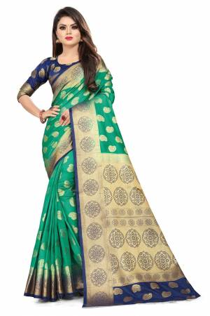 For A Proper Traditional Look, Grab This Heavy Weaved Silk Based Designer Saree In Sea Green Color Paired with Navy Blue Colored blouse. This Saree and Blouse Are Fabricated On Art Silk Which Gives A Rich Look To Your Personality.